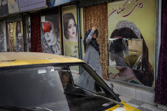 Many beauty salons in Kabul have been defaced or covered up to remove images of women.