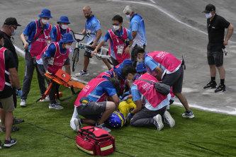 Saya Sakakibara of Australia is stretchered away by medics after crashing in the women's BMX semi-finals at the Tokyo Olympics.