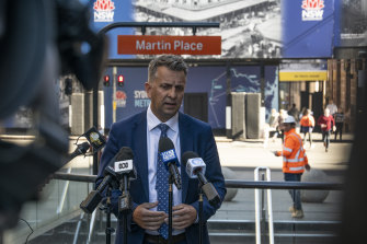 Minister for Transport and Roads Andrew Constance makes an announcement on public transport fares in Martin Place on Wednesday.