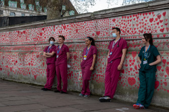 """NHS at the National COVID Memorial - many frontline workers were insulted by the suggestion they had """"cowered"""" from coronavirus."""