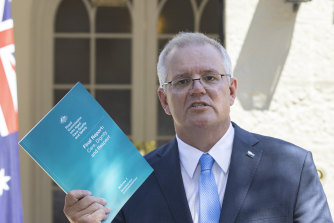 Prime Minister Scott Morrison releasing the royal commission into aged care report.