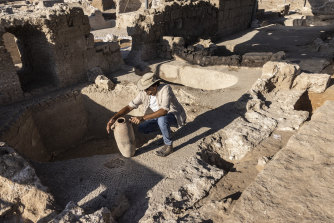 Avshalom Davidesko from Israel's Antiquities Authority examines a jar in the ancient winemaking complex south of Tel Aviv.