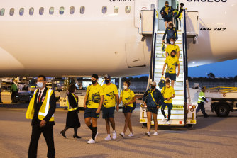 Australian Olympians exit their plane at Sydney International Airport, after returning from the Tokyo Olympics Games on Sunday.
