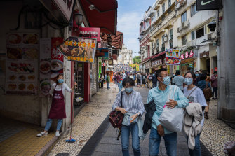 Chinese tourists in Macau wear masks amid the coronavirus outbreak.