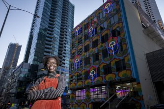 Atong Atem outside Hanover House, which has been transformed by her work  'Outdoor Living', 2021.