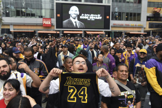 LA Lakers fans flocked to Staples Centre on Sunday to mourn the loss of their former star.