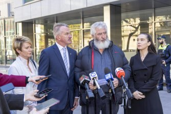 Constable Josh Prestney's parents Belinda and Andrew, Leading Senior Constable Lynette Taylor's husband Stuart Schulze, and Senior Constable Kevin King's partner Sharron Mackenzie outside court after the hearing.