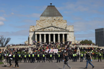 Police surround protesters at the Shrine of Remembrance.