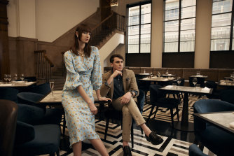 Bela wears Scanlan Theodore dress, $800, and Oroton earrings, $90,  and necklace, $360.   Zane wears Polo Ralph Lauren jacket, $1399, shirt, $169, and pants, $219, Omega watch, $17,825, and Zara shoes,$139.