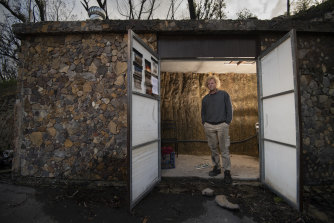 Berambing resident Lionel Buckett with his fire bunker for 20 people that was nearly finished when the bushfires hit his region of the Blue Mountains this past summer.
