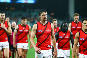 Joe Daniher leads the Bombers off the field after their loss to the Power.
