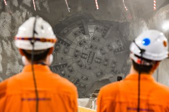 The first of two tunnel-boring machines working on the Cross River Rail project break through to the new Roma Street station cavern on Friday.