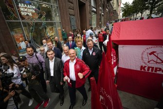 Russian Communist Party leader Gennady Zyuganov, centre in red, on a campaign march with other party activists in Moscow in August.