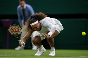 Serena Williams reacts and winces in pain.