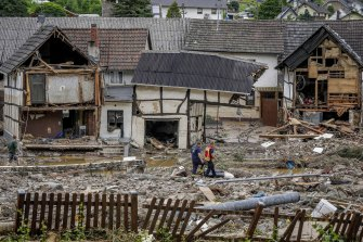 Rescuers assess the damage in the flood-hit town of Schuld, Germany.