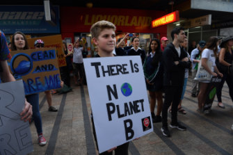 "Owen Jenkins, 14, is attending the protest outside Mr Abbott's Manly office because ""there is no planet b""."