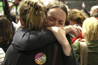 """Yes"" campaign supporters  react as the results of the votes are announced."