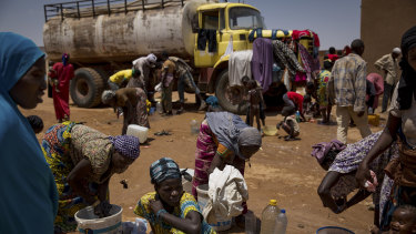 Migrants expelled from Algeria pictured in Agadez last year.