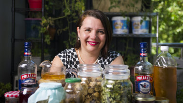 Serina Bird with an assortment of her own handmade kombucha, alcohol, jams and sauces as well as hand-picked tea leaves and mushrooms.