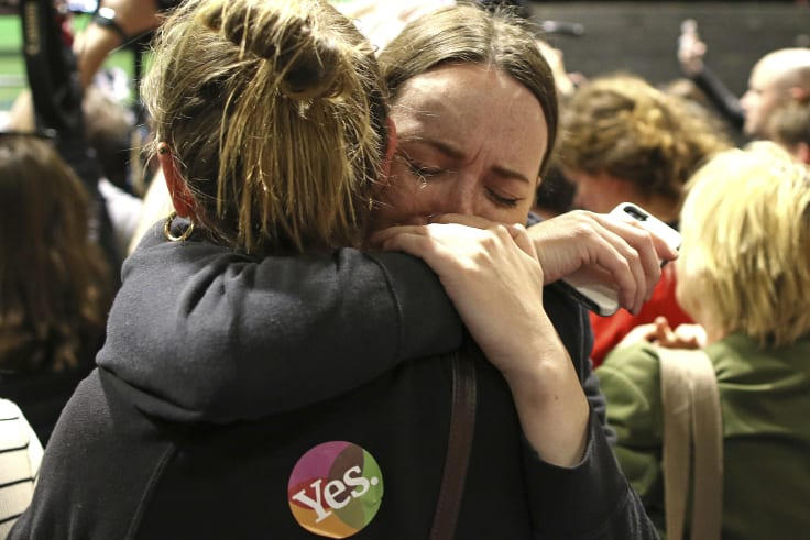 """""""Yes"""" campaign supporters  react as the results of the votes are announced."""