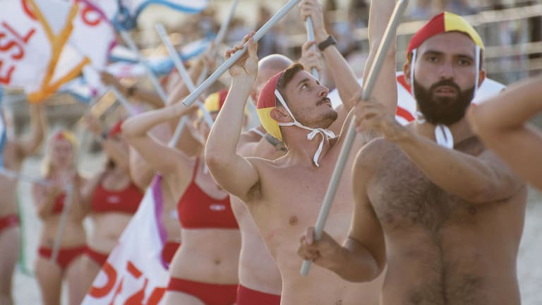 Lifesavers with Pride complete a final dress rehearsal on Bondi Beach before Mardi Gras.