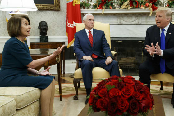 Vice President Mike Pence, looks on as House Minority Leader Representative Nancy Pelosi and President Donald Trump speak during a meeting in the Oval Office of the White House in Washington.