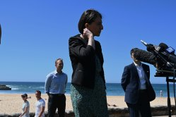 NSW Premier Gladys Berejiklian, Planning Minister Rob Stokes (left) and Customer Services Minister Victor Dominello launch the government's COVID safe plan for summer at Manly.