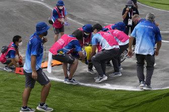 Saya Sakakibara of Australia is stretchered away by medics after crashing in the women's BMX racing semifinals at the Tokyo Olympics.