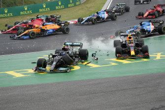 Valtteri Bottas, left, crashes out in Hungary alongside Sergio Perez.