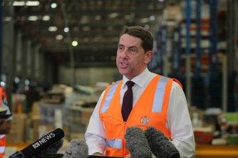 'Grab a vax, grab a snag,' Treasurer says as Qld declares southern Tasmania a COVID hotspot