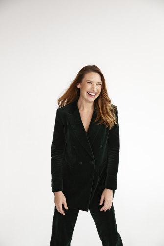 Anna wears an E Nolan velvet suit.