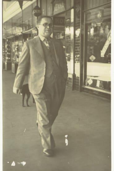"Abraham ""Jack"" Rudov strides proudly along Dean Street, Albury, close tohis store, Rudov Modes."