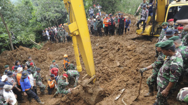 Rescuers recover the body of a victim of a landslide in Cijeruk, West Java, Indonesia, on Tuesday.