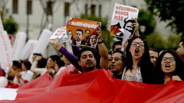 Demonstrators shout slogans against Keiko Fujimori, daughter of jailed former president Alberto Fujimori, blaming her party for corruption charges against President Pedro Pablo Kuczynski in Lima.
