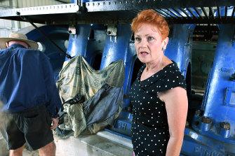 Senator Hanson is seen inspecting old diesel machinery in Ayr on Friday.
