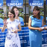 NSW Premier Gladys Berejiklian greets local voters alongside Liberal candidate for East Hills Wendy Lindsay, right,  during a visit to the Revesby Public School on Saturday.