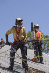 Crews help minimise bushfire hazards at a home in Brewarrina.
