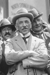 Australian Prime Minister Billy Hughes outside Central Hall, Sydney, on his return from Paris peace talks in 1919. Almost 30 years later, in the wake of another war, he worried about the financial cost facing Australian taxpayers.