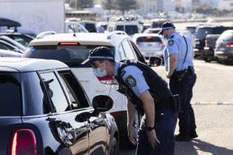 Police conduct public health order compliance checks at Bondi Beach on Sunday.