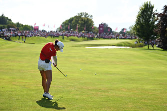 Minjee Lee plays an approach shot on the 18th hole during the playoff.