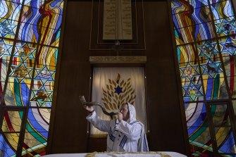 Rabbi Paul Lewin blows the shofar at the North Shore Synagogue in Lindfield.