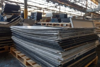 Solar panel components waiting for recycling at a Reclaim PV warehouse.