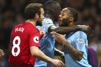 Derby day: Tempers flared at Etihad Stadium in the intra-city clash.
