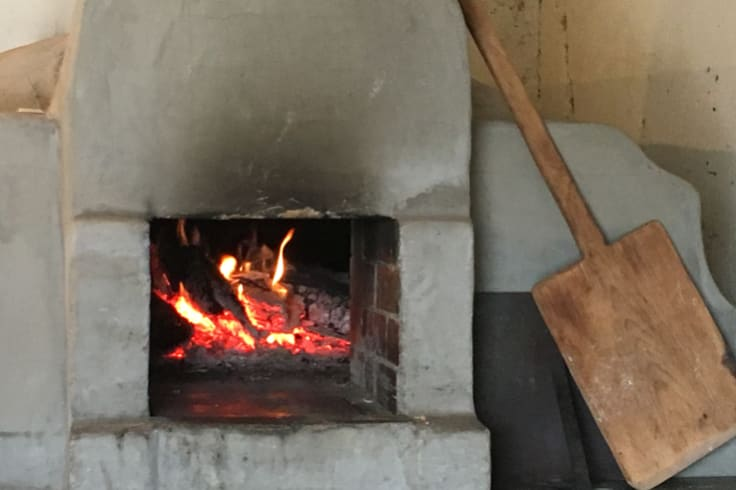 Wood-fired oven used to bake bread and pizza in the  afterheat in the Ben Hall  Cottage at the rear of The  Sir  George in Jugiong.