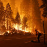 Hundreds rescued from fires by helicopter as heatwave bakes California