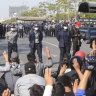 Myanmar police crack down on crowds defying protest ban