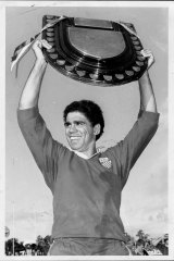 Mark Ella proudly displays the Shute Shield at the end of the grand final in 1984.
