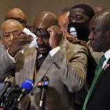 George Floyd's brother, Philonise Floyd, wipes his eyes during a news conference after the verdict.
