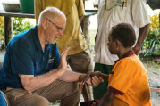 Dr Russell Corlett, left, with a patient in Papua New Guinea in 2016.