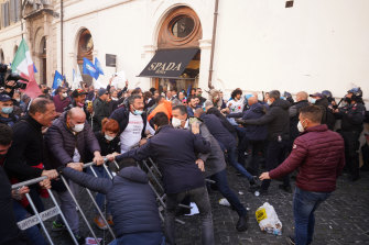 Demonstrators scuffle with police during the protest in Rome.